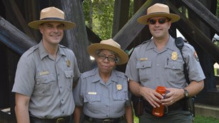 three park rangers smiling for the camera