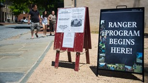 signs in the park advertising ranger programs