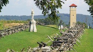 at Antietam; worm-fence-lined path known as Bloody Lane; showing a statue and the observation tower
