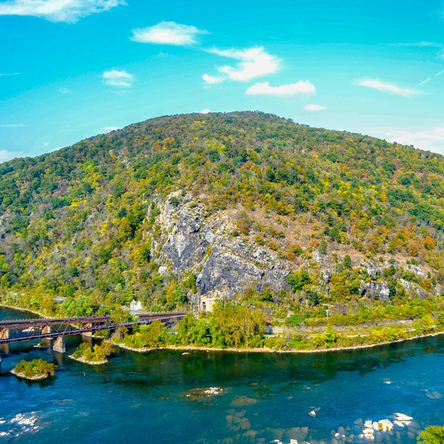 View of Maryland Heights, the town of Harpers Ferry, the railroad tracks, and convergence of rivers.