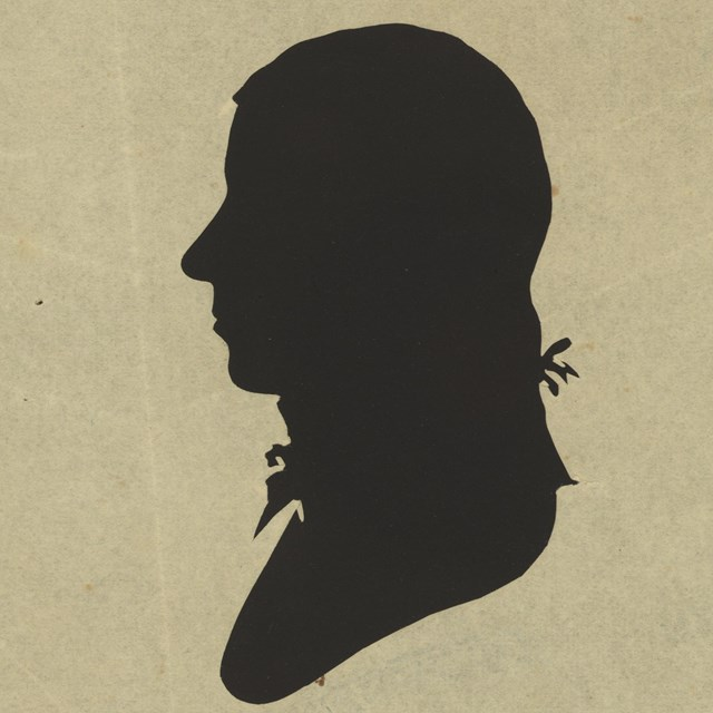 silhouette of a man facing left