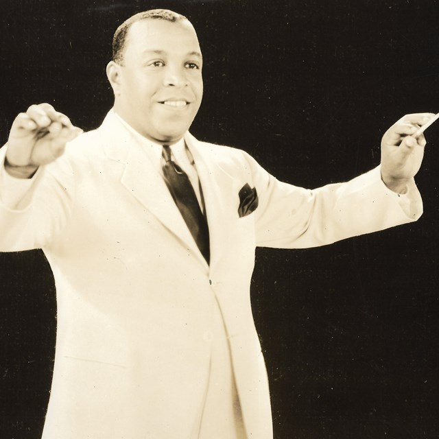 image of Don Redman posed as if conducting his orchestra