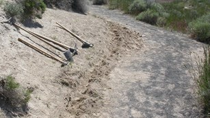 shovels off trail side