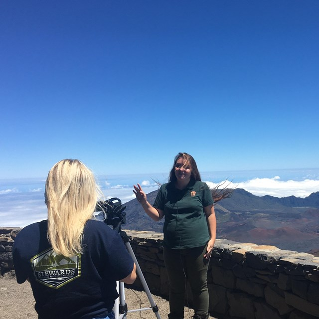 Two park interns film an educational video at the crater rim.