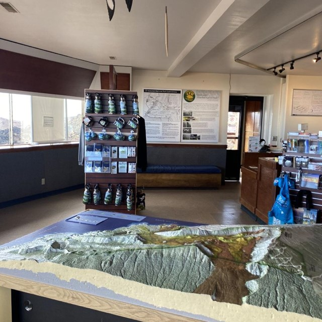 The interior of a visitor center featuring a 3D model of a mountain