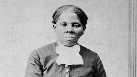 1871 Image of Harriet Tubman looking directly at the camera with folded hands on a chair back