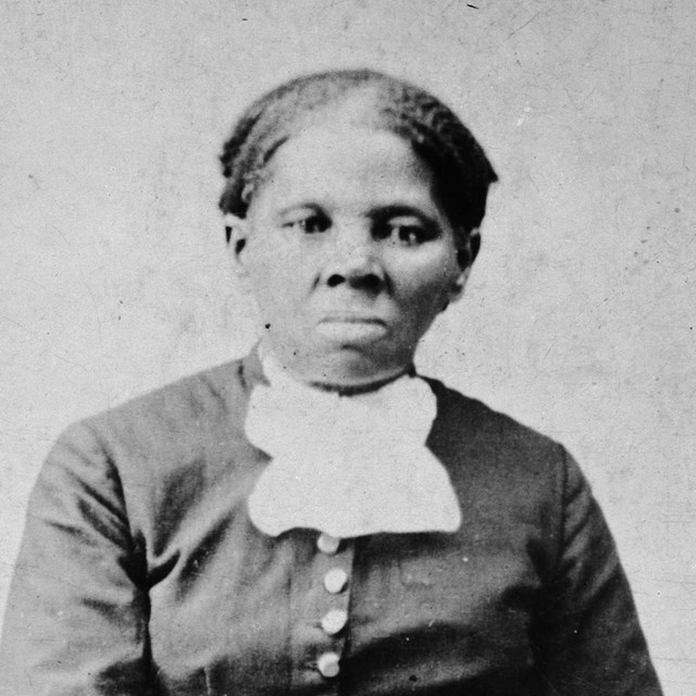 Black and white photograph of Harriet Tubman looking directly at camera