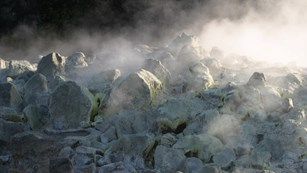 Fumes rising from sulphur-covered rocks