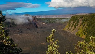 Hikers on the floor of a volcanic crater