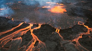 Pond of molten lava and rivulets from above