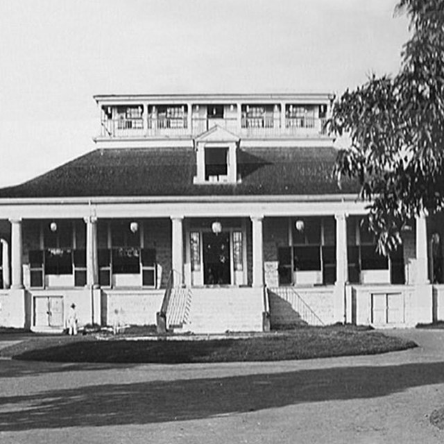 B&W photo of white pavilion with palm trees