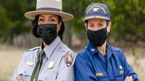 NPS ranger and United States Public Health Service Officer pose for centennial anniversary photo