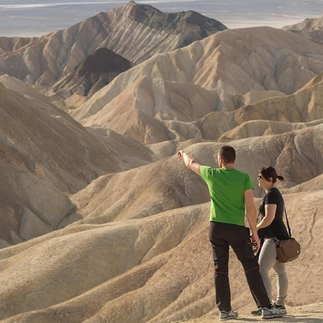 Man and woman look out towards Death Valley