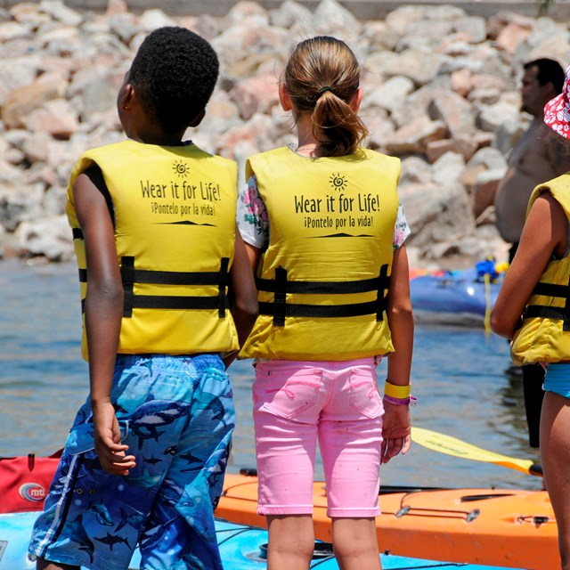 Kids wearing life jackets