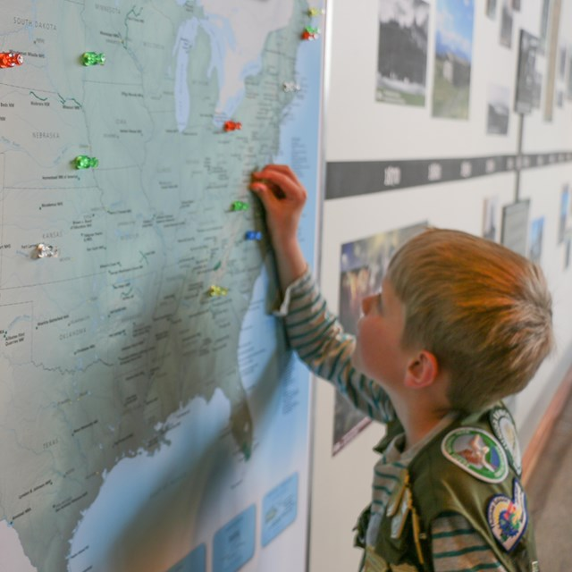 Young boy looking at a map of the United States