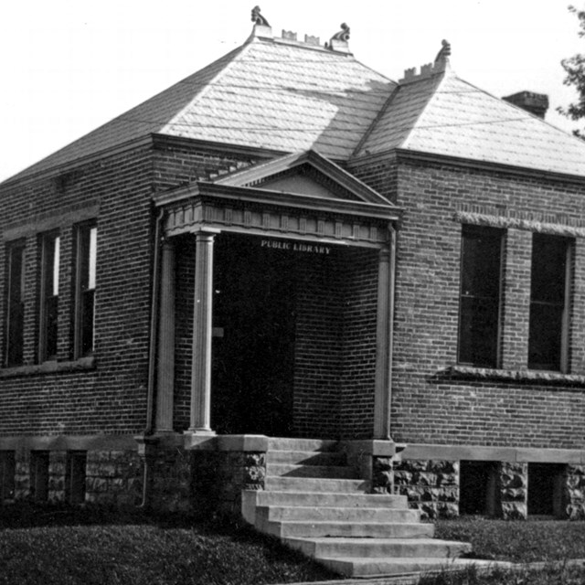 A 1908 photo shows a small town library building.