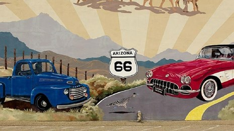 Mural of cars with Route 66 sign.