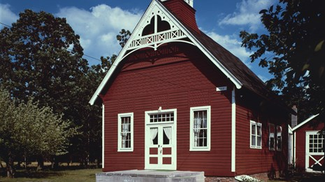Red one-room school house with white trim in Cape May, New Jersey