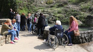 Visitors enjoy standing and sitting near the Hot Water Cascade