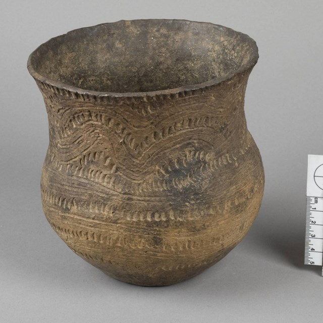Caddoan ceramic jar decorated with incising and rocker stamping, ca 1300 AD