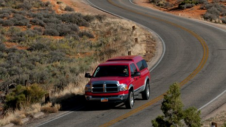 a red truck on a paved road
