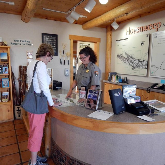ranger helping visitor at front desk