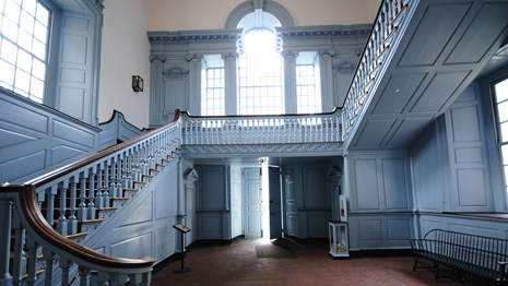 Color photo of the staircase in the south vestibule of Independence Hall.