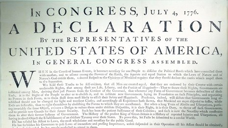 Color photo showing a detail of the Declaration of Independence printed document.