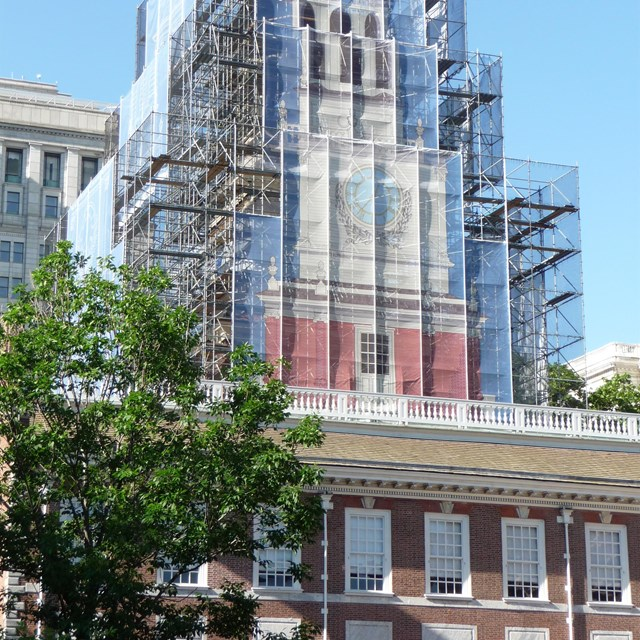 Color photo showing scaffolding around the Independence Hall tower.