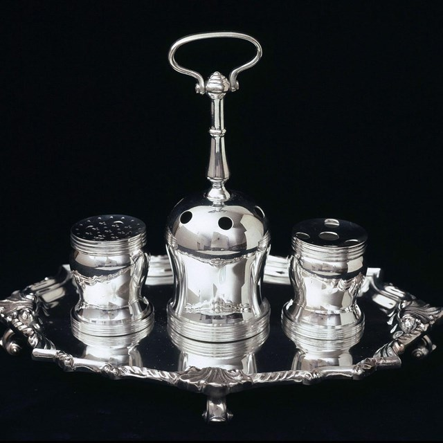 Photograph of the Syng Inkstand, with three silver containers for ink, quills, and sand.