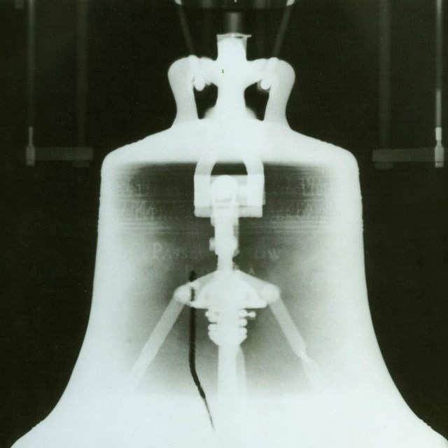 Black and white photo showing an X-ray of the Liberty Bell.