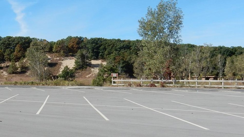 Empty parking lot of West Beach with phone number of 219-395-1003 listed overhead
