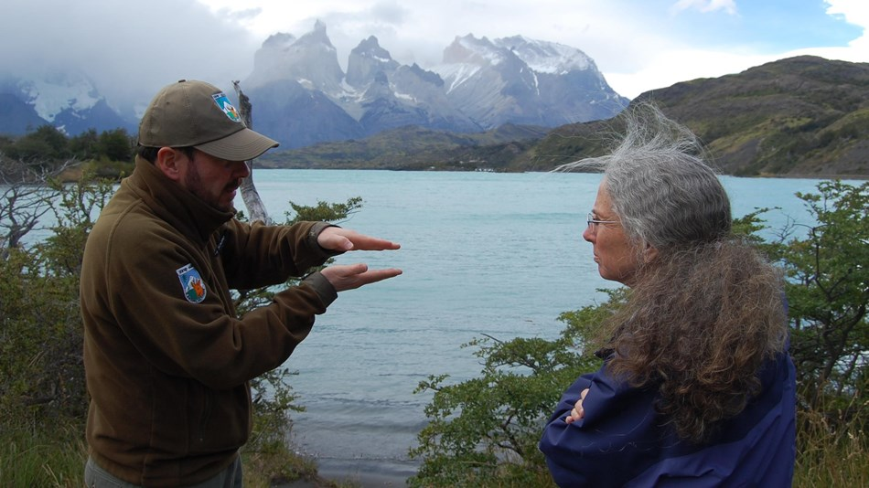 NPS and Chile park staff meet in front of a lake at Tores del Paine National Park, Chile.