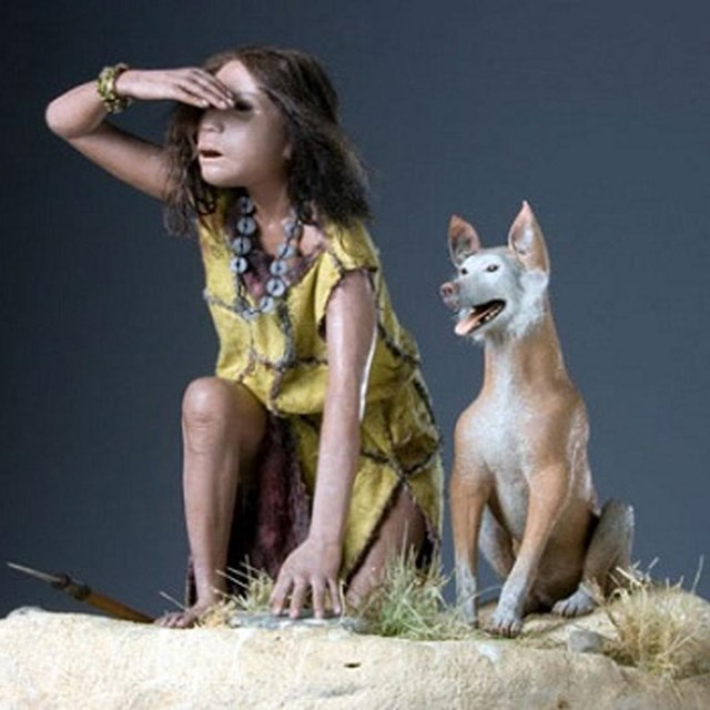 A miniature model of a native american indian girl with dog.