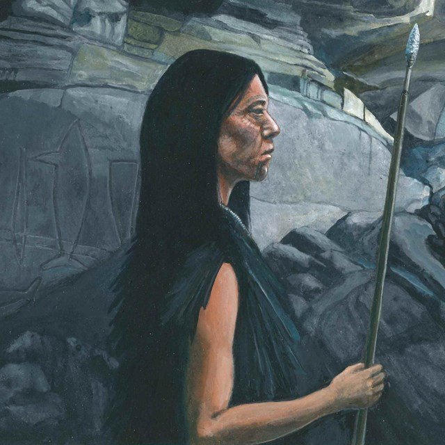 Native American Indian woman standing in cave looking outside.