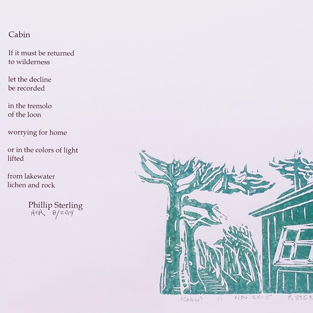 A poem written on the left with a teal colored cabin on the right