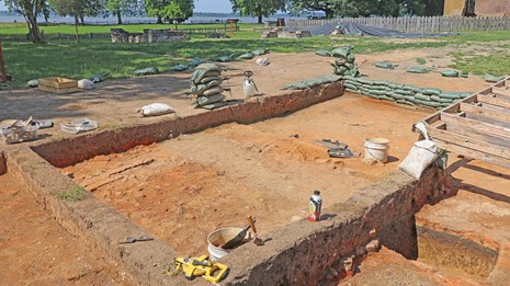 An archaeological dig exposes the foundations of many buildings.