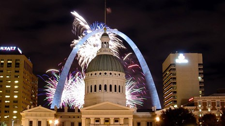 fireworks behind the Gateway Arch and Old Courthouse