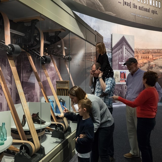 people examining turning mercantile display in the Manifest Destiny gallery