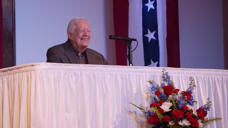 President Carter speaking to the assembled audience on Presidents' Day