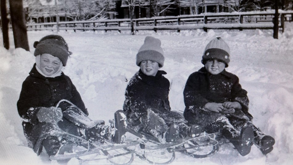 John and Joe Kennedy Jr sled in Brookline with a friend.