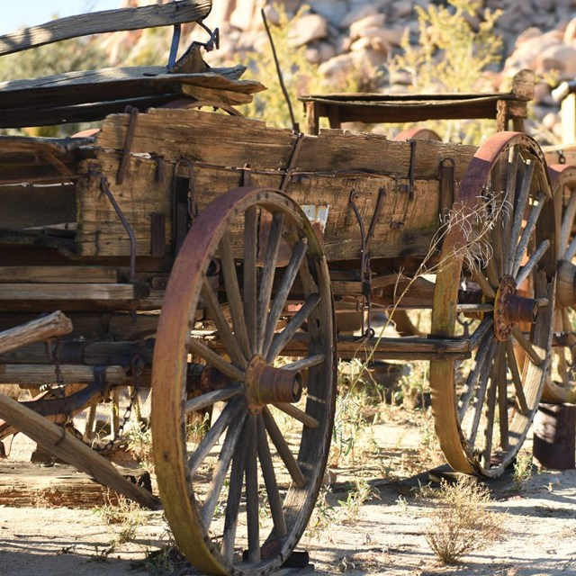 old wooden wagons with rusty metal-rimmed wheels