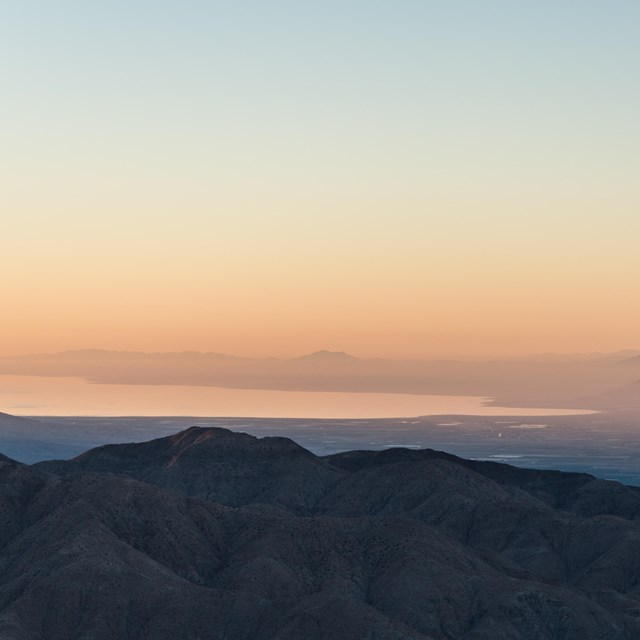 Color photo at first light looking out over the Salton Sea to the south of Joshua Tree.