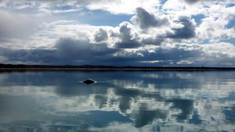 Clouds reflecting in Naknek River.