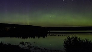 The Northern Lights above a lake.