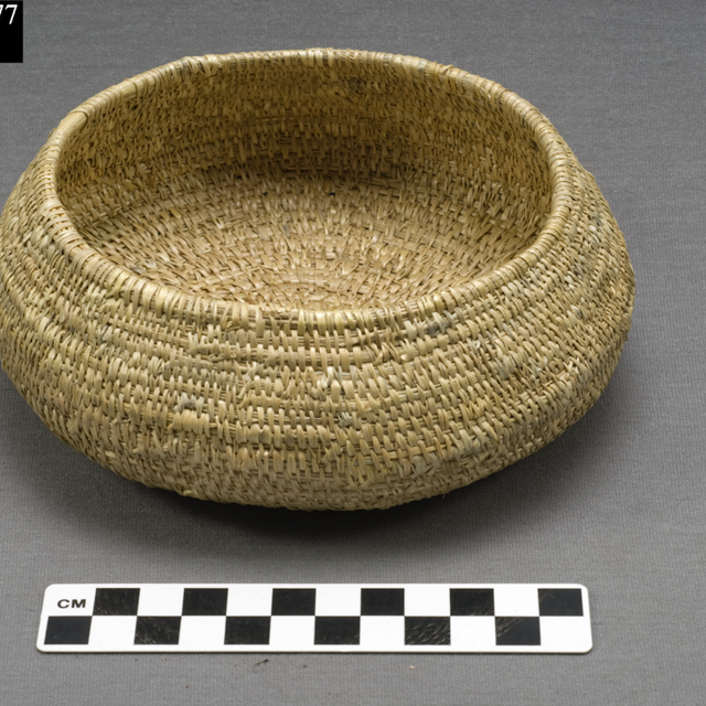 A woven bowl next to a ruler