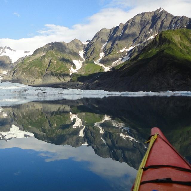 Kayaker viewing Pedersen Glacier