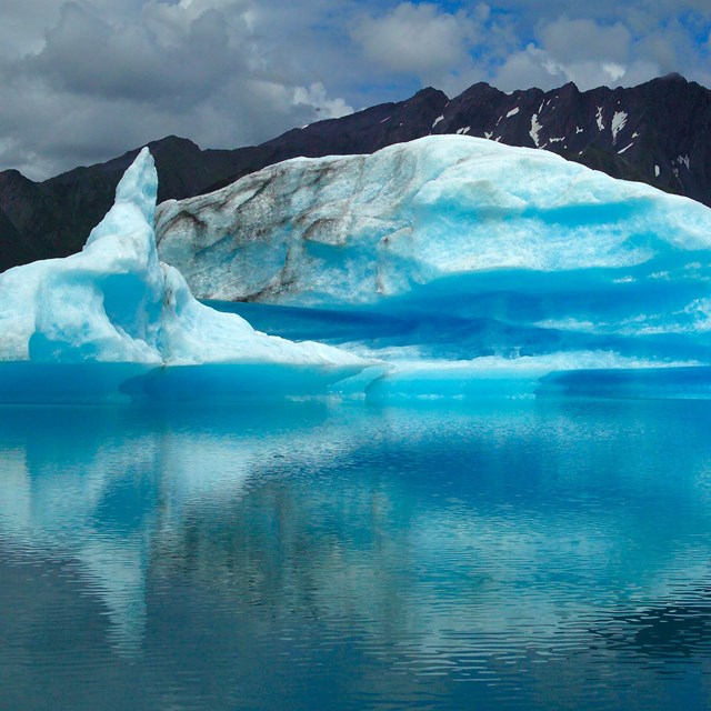 Blue iceberg floating in Bear Lagoon.