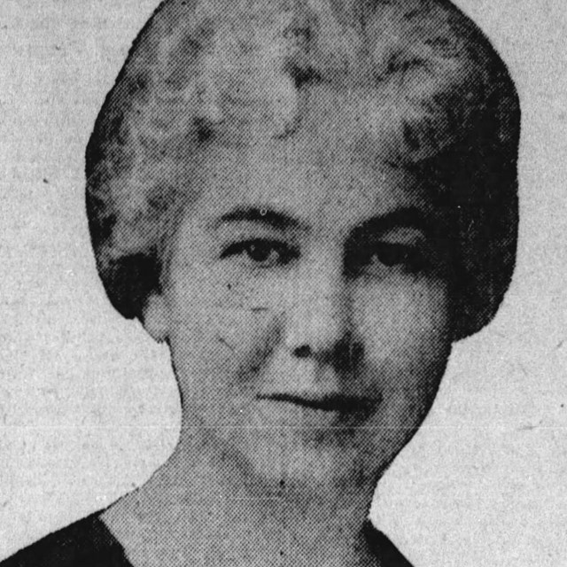 A photograph of a woman from the neck up.