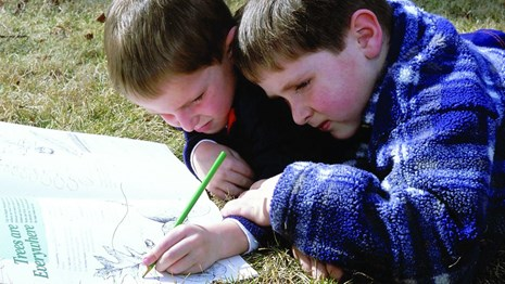 Two kids working on a Junior Ranger activity